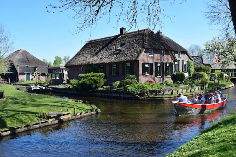 "Canals of Giethoorn, the Netherlands. Read tips on one day in Giethoorn, ""the Venice of the North"" with tips on how to get from Amsterdam to Giethoorn, things to do in Giethoorn, and where to eat in Giethoorn. #Giethoorn #travel #Netherlands #Dutch"