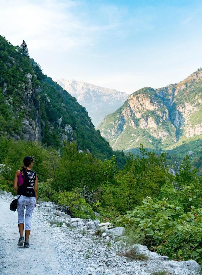 Lavdi hiking in Albania, one of the countries that Kosovars can visit without a visa. Read why passport privilege matters for millions around the world. #travel #visas #passports #privilege