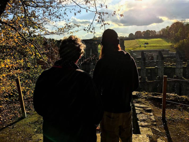 Family admiring ruins in Belgium. Read tips for traveling with your parents-in-law! #travel