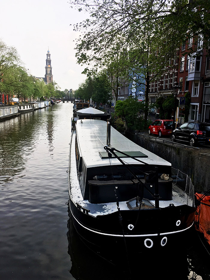 Canal in Amsterdam. Read about the best things to do in Amsterdam during your long weekend in Amsterdam with the perfect three day itinerary for Amsterdam! #Amsterdam #Netherlands #travel