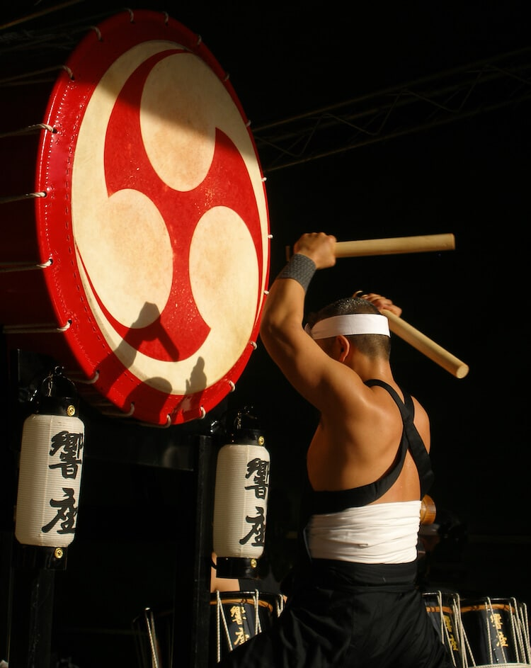 Japanese drumming performing a Taiko performance in Tokyo. Read about five things to do in Tokyo to learn about Japanese culture! #travel #japan #tokyo #asia