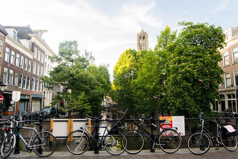 Bicycles by canal in Utrecht. Read about what to do in Utrecht in this perfect day trip from Amsterdam! #travel #netherlands #Utrecht #europe