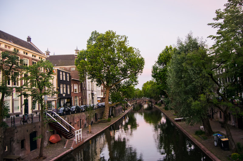 Sunset on canals in Utrecht. Visit the most beautiful day trip from Amsterdam, Utrecht. Consider spending one day in utrecht using this guide of things to do in utrecht! #travel #utrecht #netherlands #europe #canals