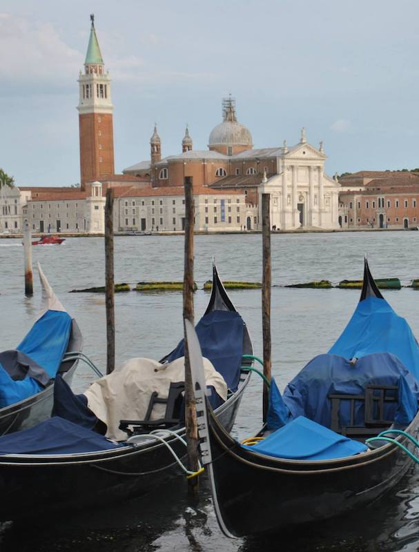 Gondolas in Venice Italy. Read why you need to include Venice on your itinerary for Europe and more tips for creating the perfect Europe itinerary! #travel #europe #venice #italy