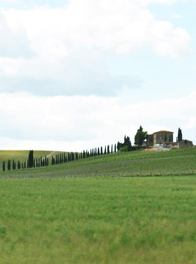Rolling hills in the Tuscan countryside. Read why you should include Tuscany on your first trip to Europe with the perfect plan for visiting Europe for first time visitors! #travel #tuscany #italy #europe
