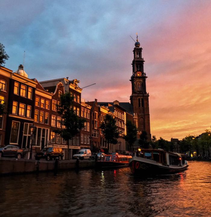 Sunset cruise in Amsterdam, the Netherlands. Amsterdam must be on your European itinerary if you're visiting Europe for the first time! #travel #Amsterdam #netherlands #europe