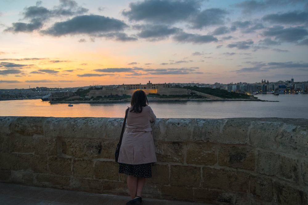 Malta views wearing clothes from a carry-on bag. Read tips on how to travel with only a carry-on bag in any climate! #travel #packing