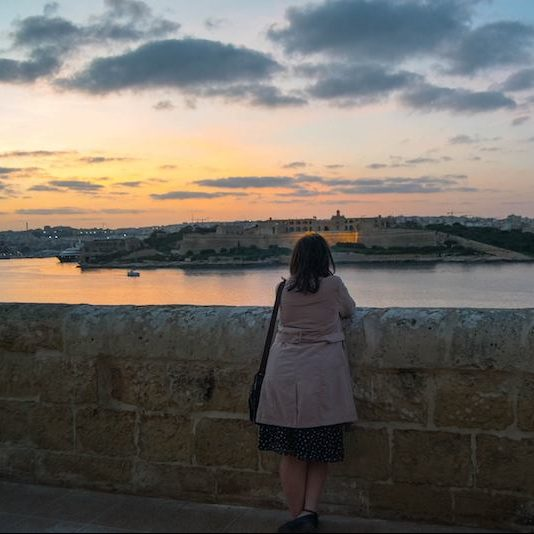 View from Valletta Malta at sunset. Read what to do in Malta during four days in Malta with the perfect Malta itinerary! #travel #malta #valletta #sunset #europe #UNESCO