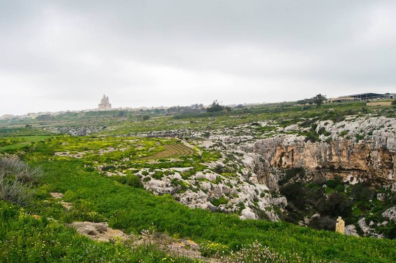 Countryside of Gozo, Malta's other island, that you must include in your Malta itinerary. Read how to get around Malta without a car and what to do on Gozo in one day! #travel #gozo #malta #europe