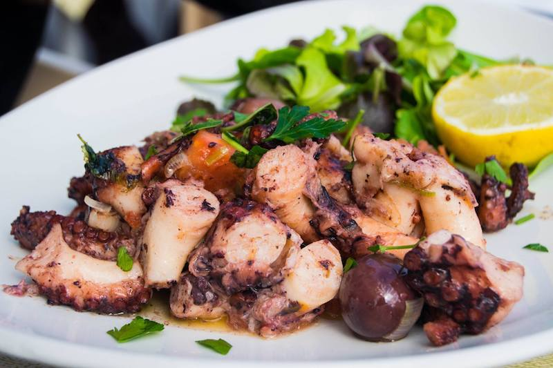 Octopus in Marsaxlokk Malta. For the best seafood in Malta, you must visit Marsaxlokk, a fishing village outside of Malta. Read what to do on a weekend break in Malta! #travel #food #malta #europe #seafood