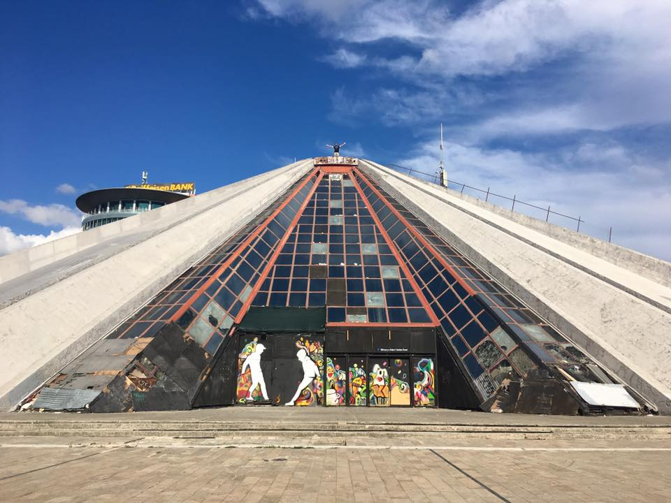 The pyramid of Tirana, one of the highlights of Tirana Albania. Read about what to do in Tirana and what to include on your Albania itinerary. #Albania #Tirana #Travel #Europe #Balkans
