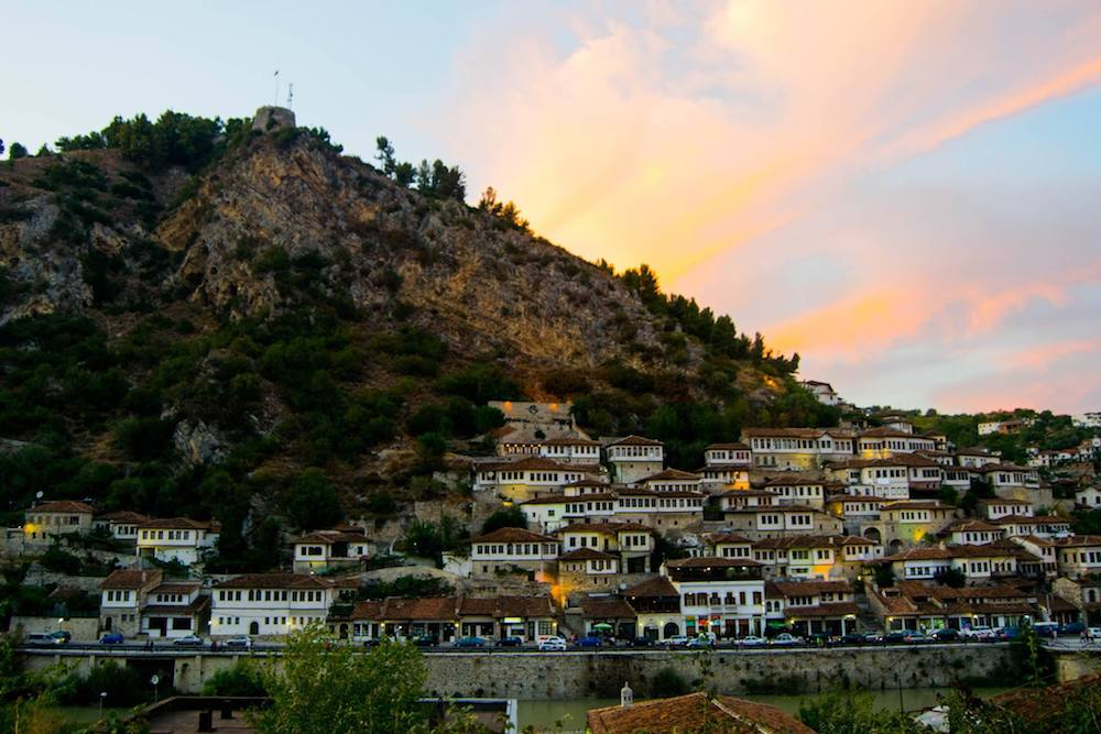 Sunset in Berat Albania, one of the most beautiful cities in Albania. Read why you must visit Berat Albania! #travel #berat #albania #balkans #UNESCO