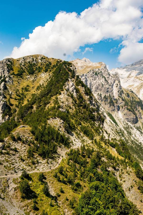 Beautiful views of the Albanian Alps from Valbone peak in Albania from the Theth to Valbona hike. #travel #valbona #albania #theth #hiking