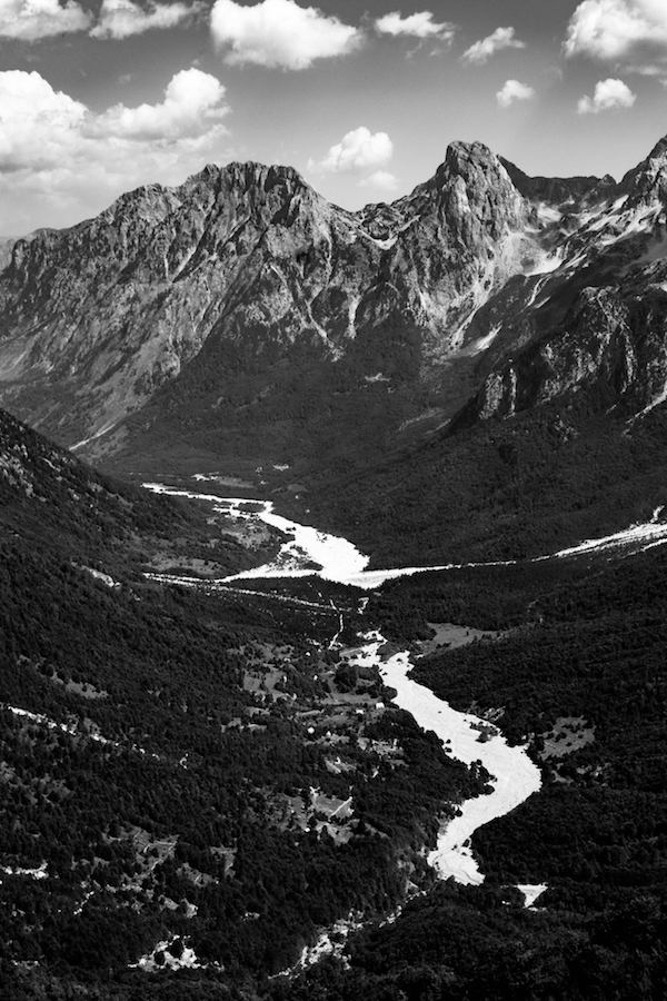 B&W photo of Valbona valley in Albania. Read tips for hiking Theth to Valbona, one of the most beautiful hikes in the Balkans! #travel #BWphotography #mountains #balkans #albania