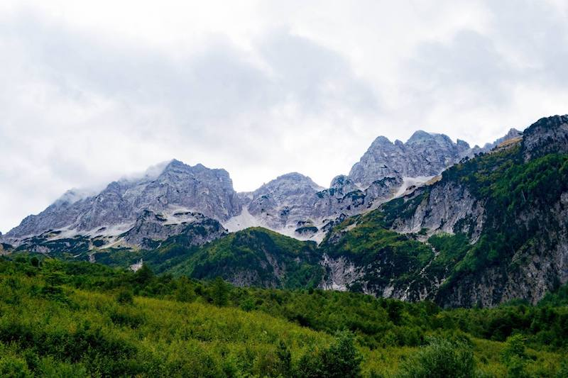 Mountains in Valbona, one of the best things to do in Albania. This mountain-side retreat is one of the highlights of Albania! #travel #Albania #Balkans #Mountains #Europe
