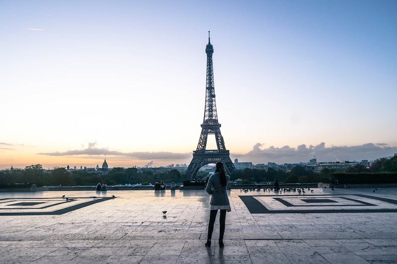 Eiffel Tower Sunrise in Paris. Read how to avoid getting scammed by the Eiffel tower with safety tips for Paris on how to avoid getting pickpocketed in Paris. #Paris #france #travel #safety #europe