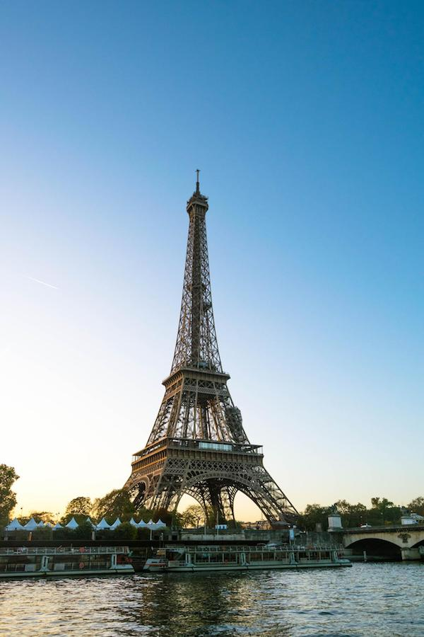 The Eiffel Tower in Paris at sunrise. Read the perfect itinerary for Europe with the best places to visit in Europe and cities to include on your European trip! #travel #Europe #Paris #France