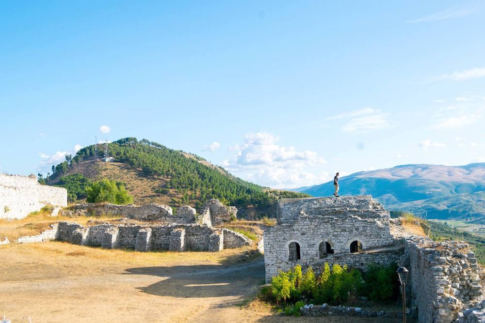 Thinking of visiting Berat, Albania? Read three reasons why you must visit Berat and about the history of Berat, one of Albania's most beautiful cities. Read about the history of Berat, the architecture in Berat, and a surprise that you'll find in this historic Albanian city!