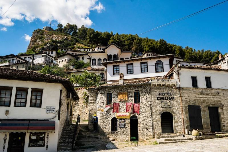 Stone buildings in Berat, Albania. This beautiful city in Albania is UNESCO recognized for its Ottoman-era architecture. You must include it in your Albania itinerary! #Berat #UNESCO #Travel #Europe #Albania