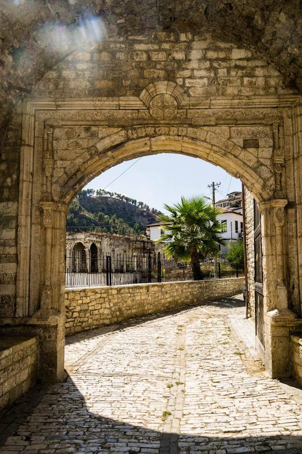 Old city fortifications within Berat Castle in Berat, Albania. This beautiful Albanian city must be included in your Albanian itinerary! Read why you must visit Berat! #albania #berat #travel #UNESCO #Balkans