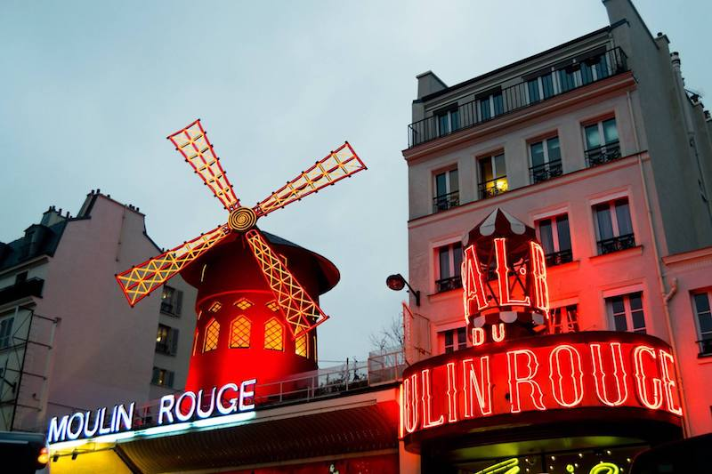 Le Moulin Rouge, one of the most iconic attractions in Montmartre that you will see along this free walking tour of the 18th arrondissement. #paris #france #travel