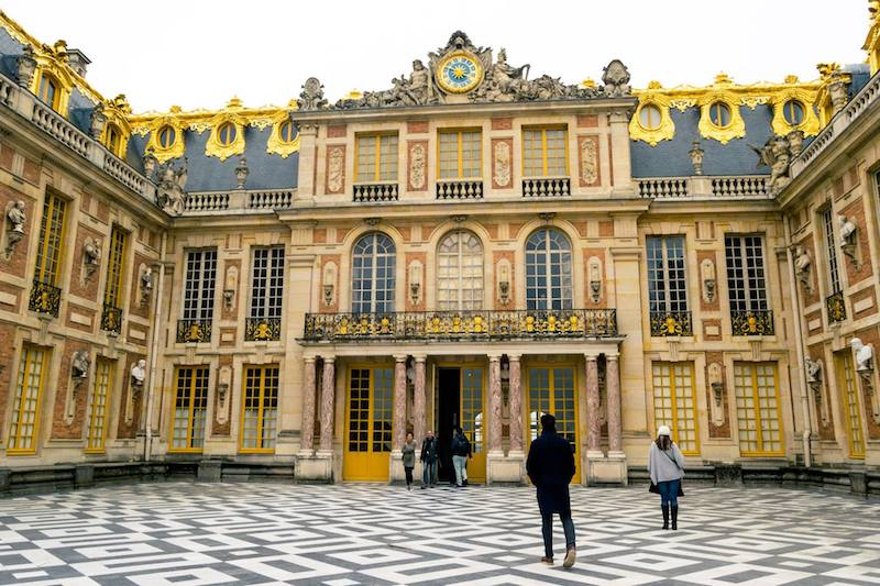 Exterior of Versailles. Read how to avoid the crowds at Versailles and the best month to visit Versailles! #travel #versailles #paris #france
