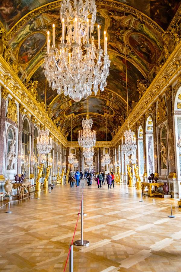 Hall of Mirrors at Versailles. Read Versailles travel tips on the best month to visit Versailles and how to avoid the crowds at Versailles! #travel #france #paris #versailles