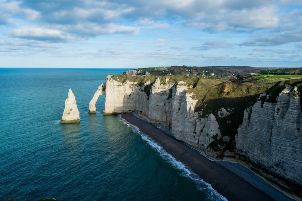 The famous cliffs of Étretat in Normandy. If you're taking a road trip in Normandy, you must put this on your Normandy itinerary! #travel #normandy #nature #france