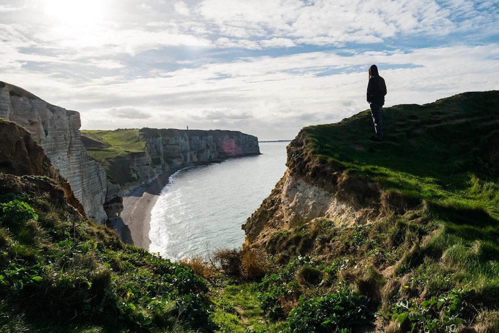 Cliffs of Étretat, one of the most famous attractions in Normandy France. Read what to do in Normandy on a long weekend trip from Paris! #normandy #france #travel #Étretat