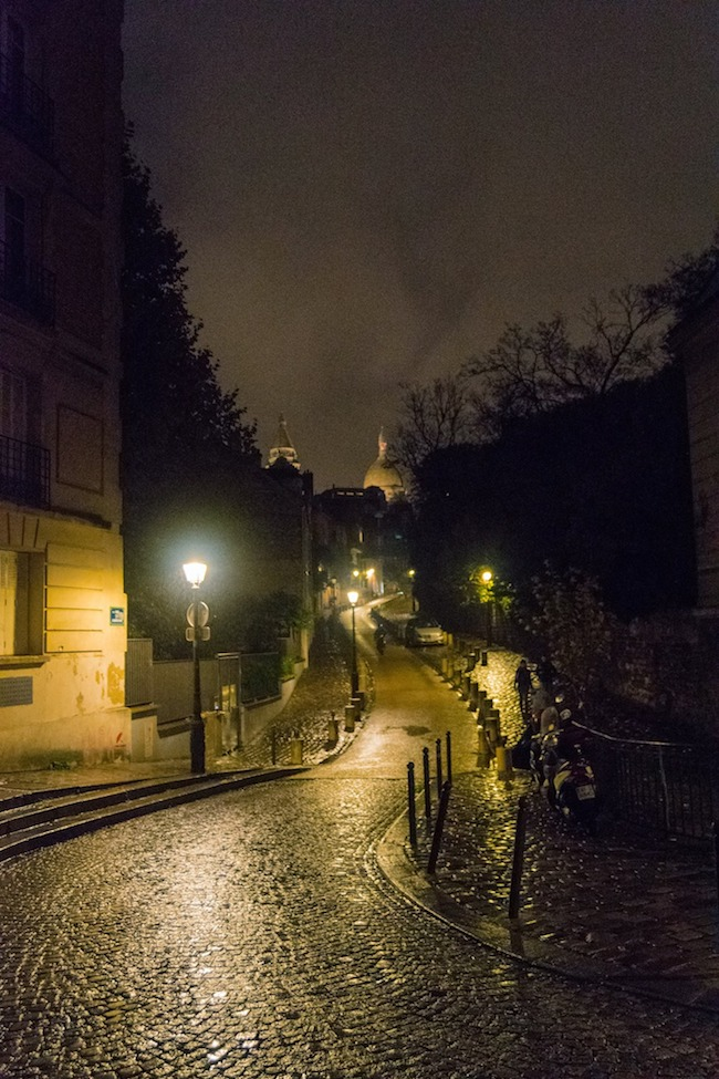 Montmartre at night. This beautiful view can be seen from Place Dalida, one of the stops on a free self-guided walking tour of Paris' 18th arrondissement. #travel #paris #france