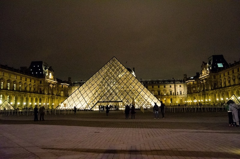 Photo of the Louvre in Paris. Read tips by an insider on how to avoid being pickpocketed in Paris and how to avoid being scammed in Paris. #Paris #france #Travel #louvre