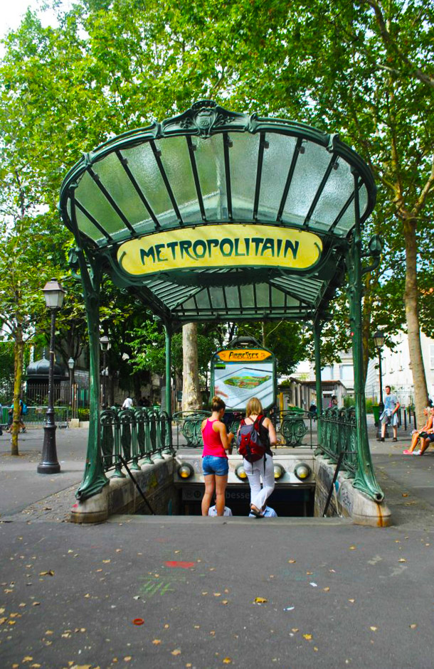 Abbesses Metro Station in Montmartre, one of the things to see in Montmartre. This historic Metro station is one of the most beautiful metro stations in Paris! #Paris #Metro #Travel