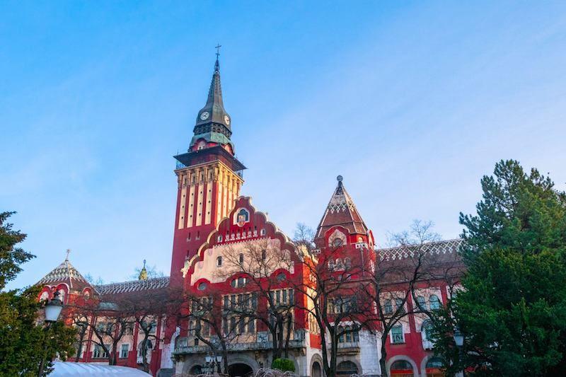 The beautiful art nouveau building that is city hall in Subotica Serbia. Read why you need to visit Subotica, one of the cutest cities in Serbia! #travel #balkans #serbia #subotica #europe #architecture #artnouveau