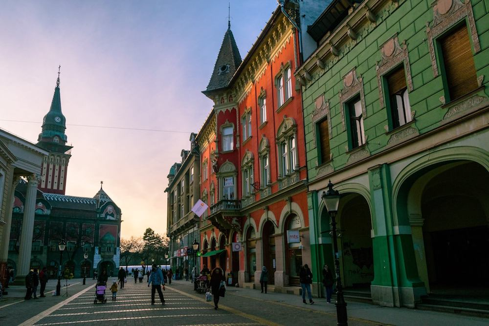 Sunset over City Hall in Subotica Serbia. Read why you must visit this art nouveau architecture gem, one of the most beautiful cities in Serbia! #travel #serbia #balkans #subotica #europe #artnouveau