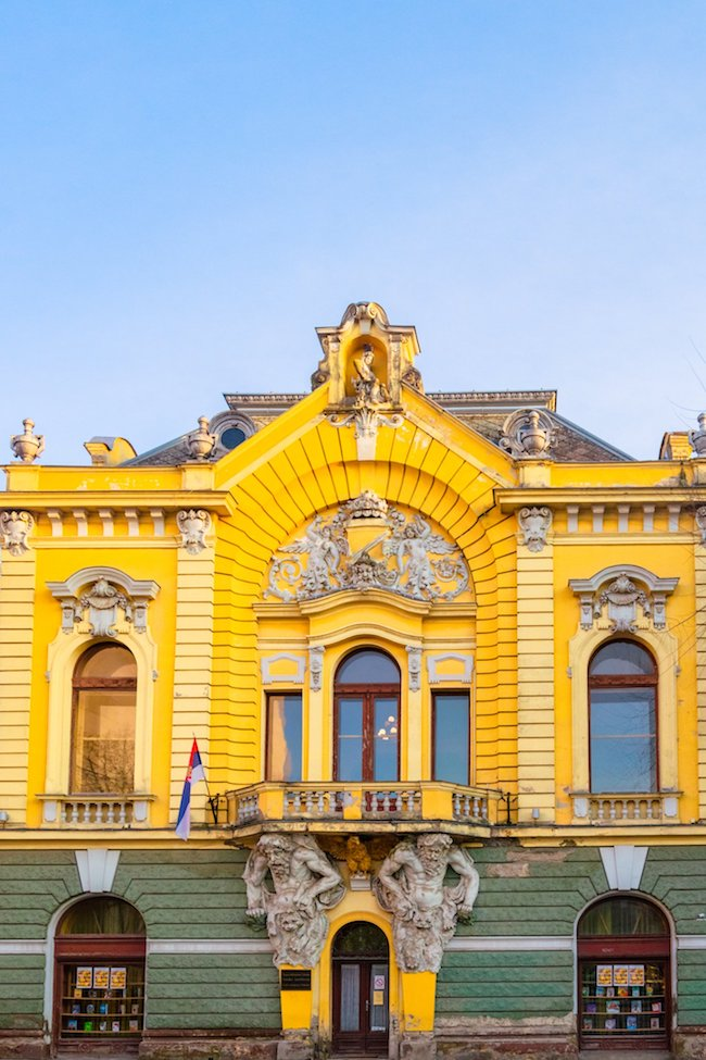Stunning art nouveau building in the Hungarian Separatist style in Subotica Serbia. Read about visiting Subotica Serbia, one of the most beautiful cities in Serbia. #travel #balkans #serbia #subotica #europe #architecture #artnouveau