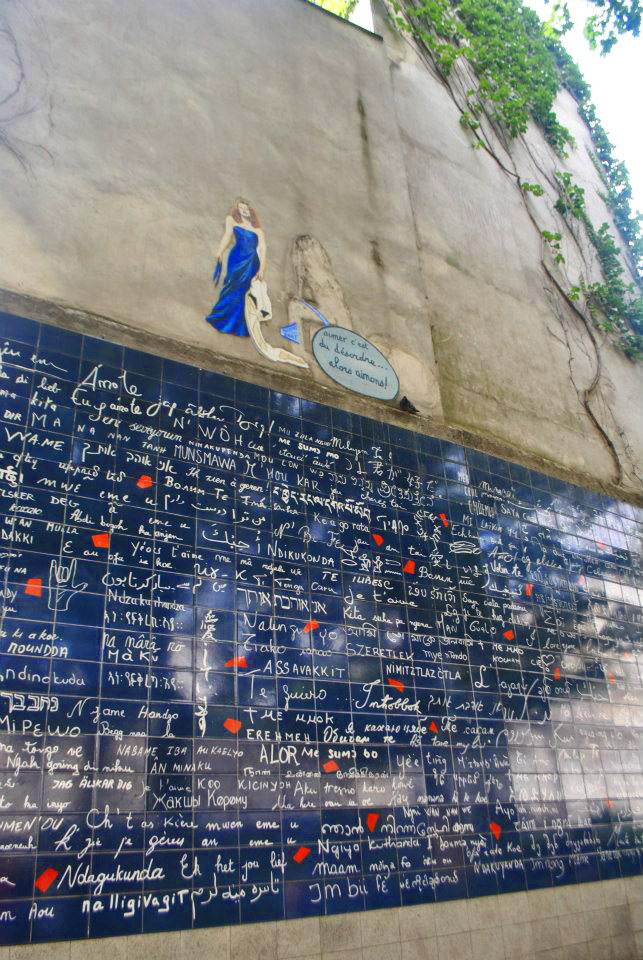 Wall of Love in Paris. Don't miss this mural with love statements in Paris while walking around Montmartre in Paris! #travel #Paris #love