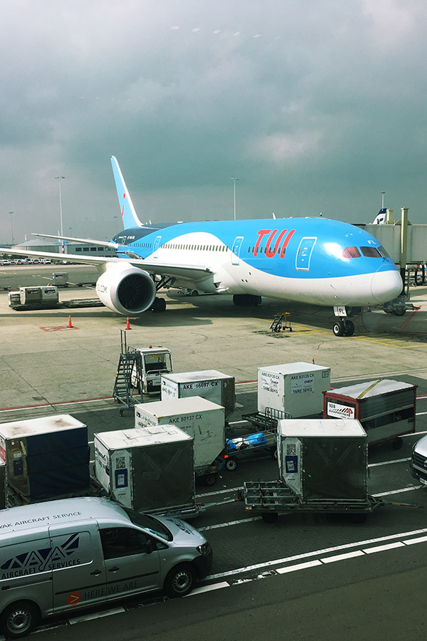 TUI airlines (TuiFly) airplane at Schiphol Airport. If you're considering flying with TUI airlines, you'll want to read this review of TUI airlines! #travel #TUI #europe