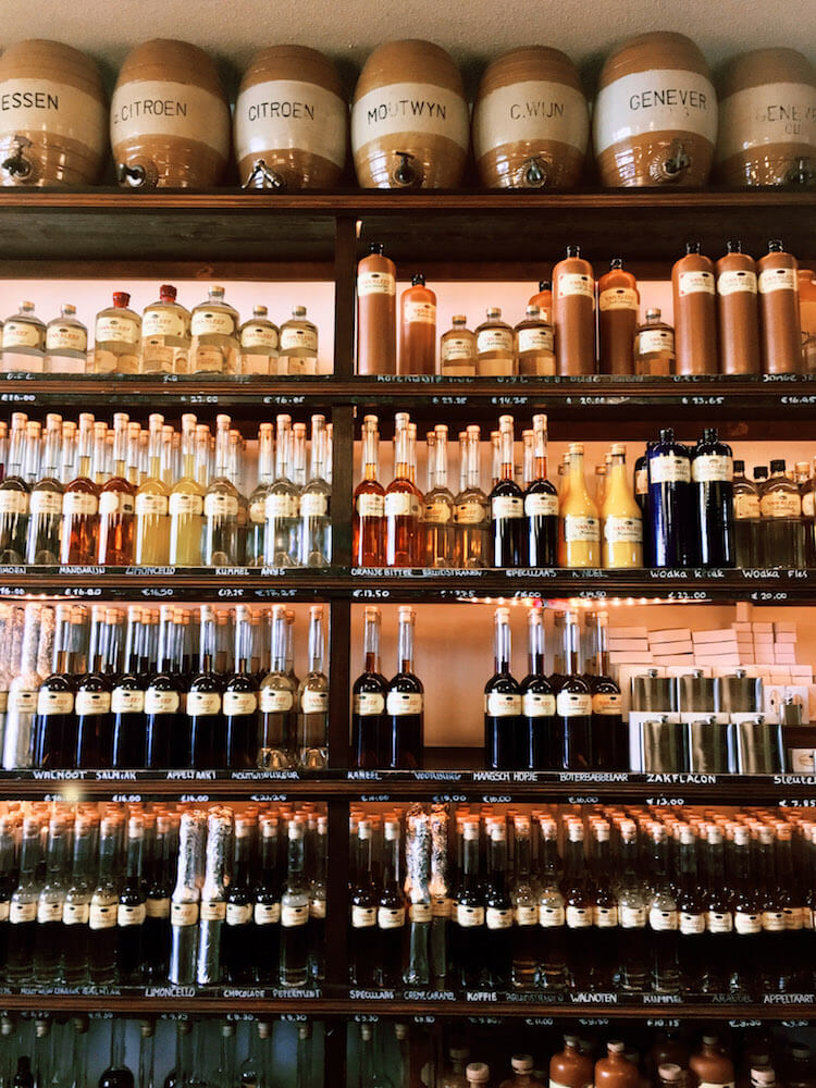 Photo of bottles of jenever/genever at Van Kleef Distillery, one of the best places to visit in the Hague during one day in the Hague. Get insider tips for what to do during one day in the Hague! #travel #Netherlands #jenever #genever #Nederland #alcohol #DenHaag #TheHague #Holland