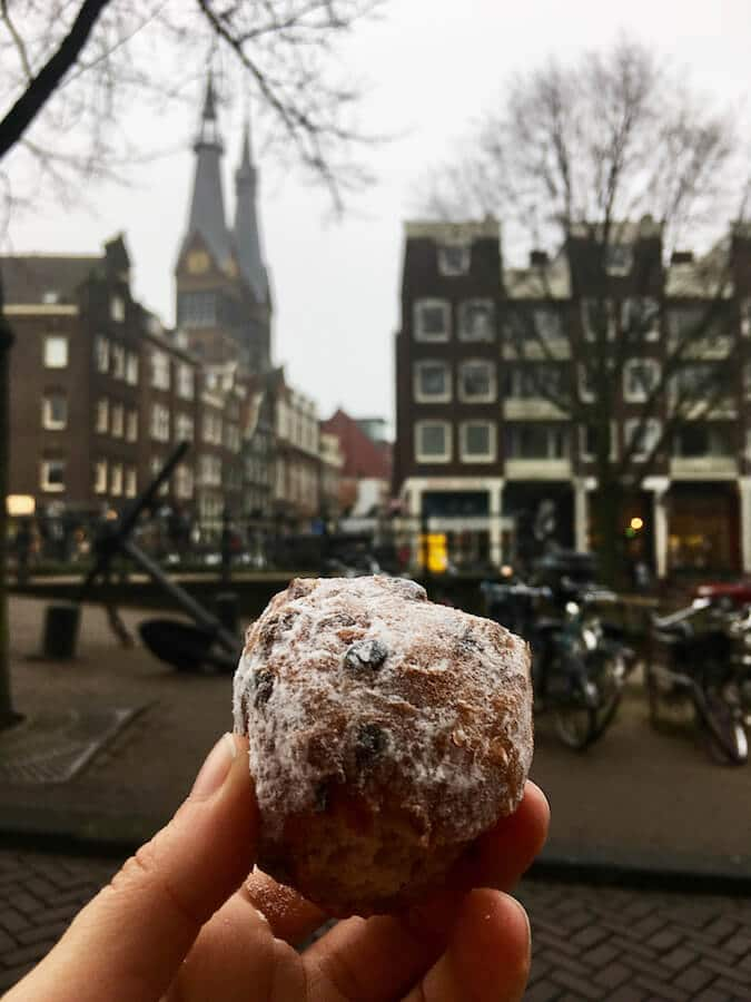 Oliebollen, a typically Dutch New Years food that you must try in Amsterdam, the Netherlands! #netherlands #holland #dutch #Amsterdam