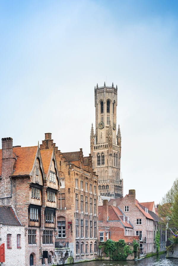 Beautiful city and canals in Bruges (Brugge) Belgium. Read what cities to visit Europe during your first trip to Europe with tips for creating the perfect European itinerary! #travel #europe #bruges #Brugge #Belgium #Belgie