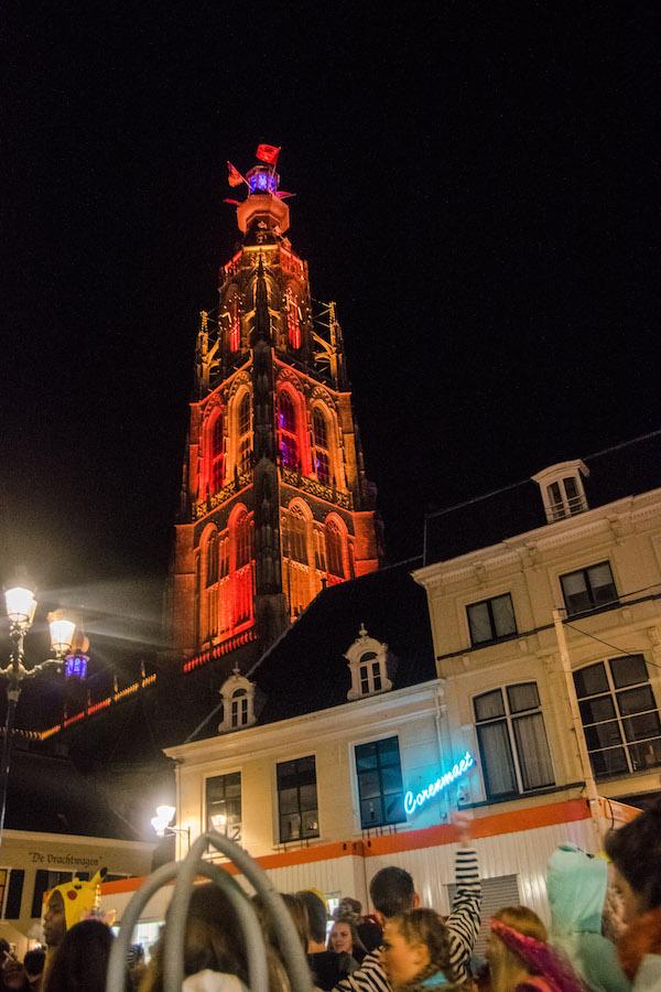 Breda's tower lit up for Carnival. Read about celebrating carnaval in Kielegat! #travel #breda #netherlands