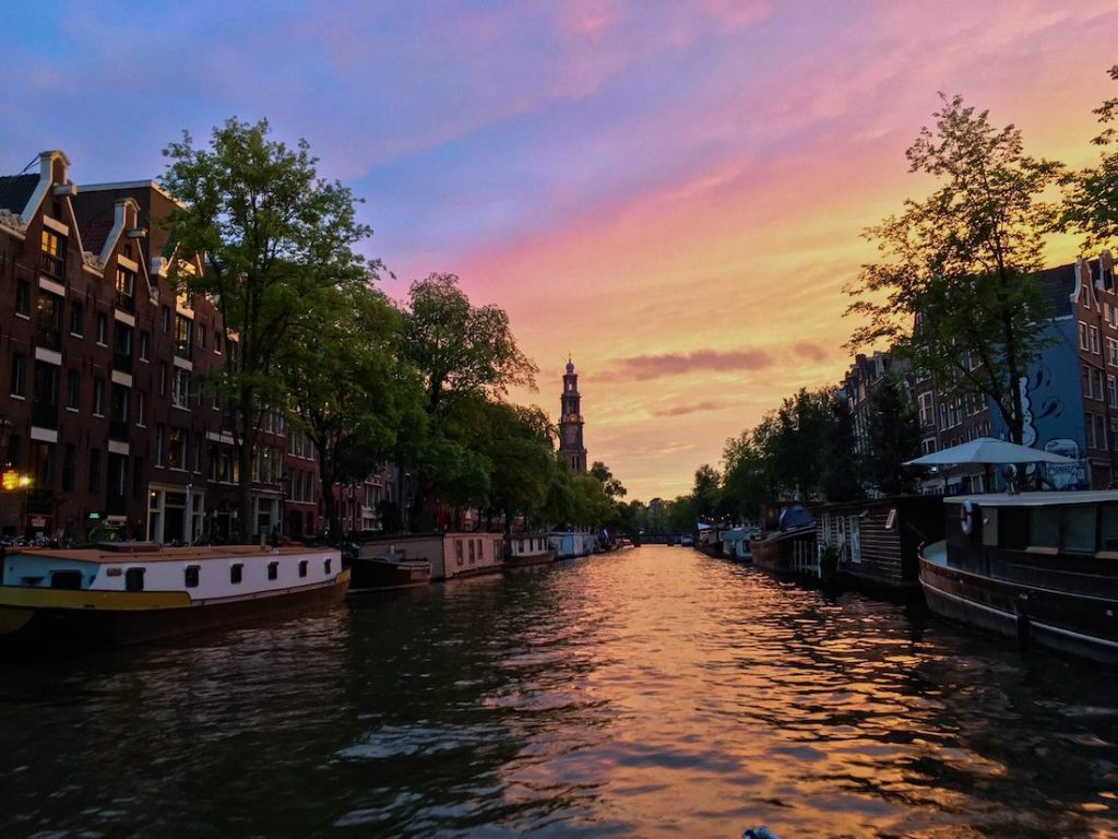 Beautiful sunset in Amsterdam, the Netherlands. Read insider tips for visiting the Netherlands written by a resident! #travel #Amsterdam #sunsets #Netherlands #holland