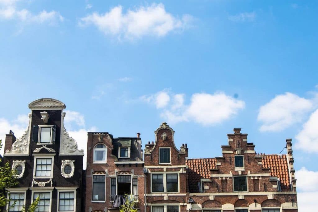 Amsterdam houses. Read what to pack for Europe in a guide by an American expat. #travel #europe #packing #amsterdam