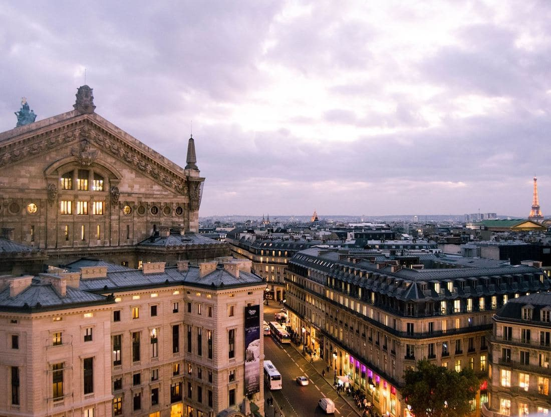 View over Paris at Galeries Lafayette, one of the best free viewpoints in Paris. Be sure to include this beautiful viewpoint in your Paris itinerary! #travel #paris #france