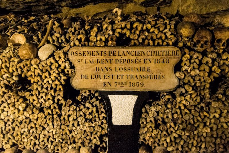 Bones in the Paris Catacombs, one of the best things to do in Paris during your trip to Paris. Read insider tips for the perfect Paris itinerary. #travel #paris #europe #france