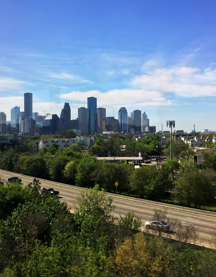 View of Houston, Texas. Read how to visit the United States without a car and other tips for saving money on travel in the US in this guide to budget travel in the US written by an American. #travel #USA #America #United States