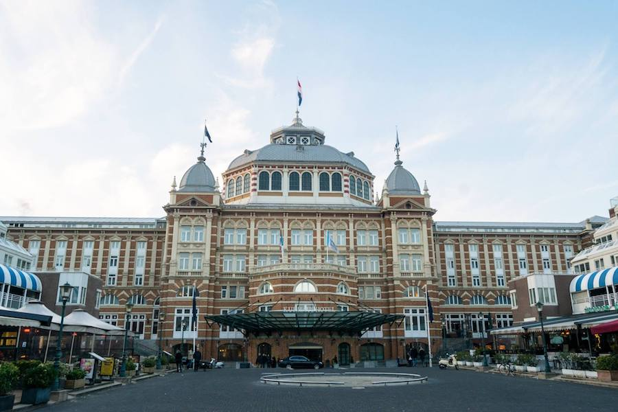 Kurhaus, one of the landmarks of Scheveningen. Read about the best areas to stay in the Hague. #travel #hotels #holland