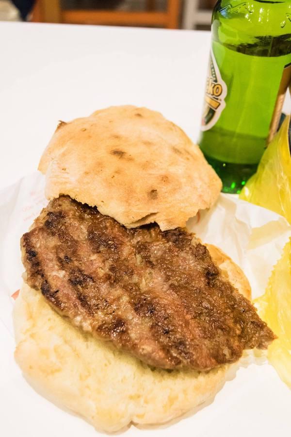 Pljeskavica, one of the best Serbian foods to try in Serbia. Read about where to eat in Belgrade, Serbia in this food guide to Belgrade! #travel #belgarde #serbia #Pljeskavica #balkans