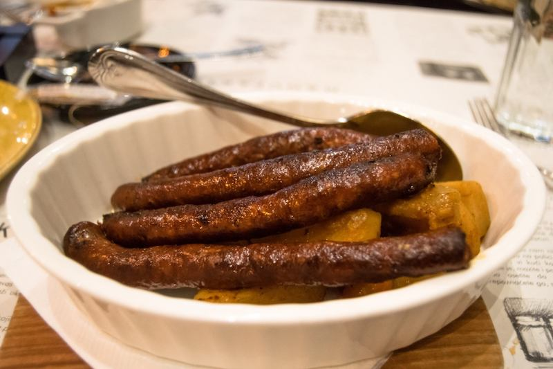 Serbian sausages in Belgrade, Serbia. Read about where to eat in Belgrade, Serbia with the best restaurants, as recommended by locals. #travel #food #serbia #balkans #belgrade