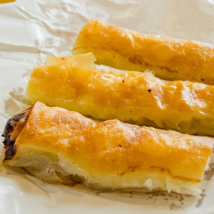 Burek, one of the best foods to try in Serbia. Read on where to get the best burek in Belgrade and more tips on the best places to eat in Belgrade, Serbia! #belgrade #serbia #travel #balkans